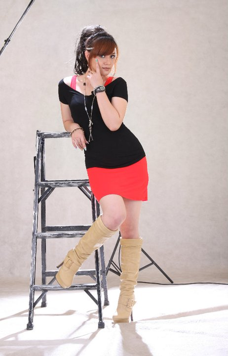 Model and Actress, Pearl Win in Red Short Dress