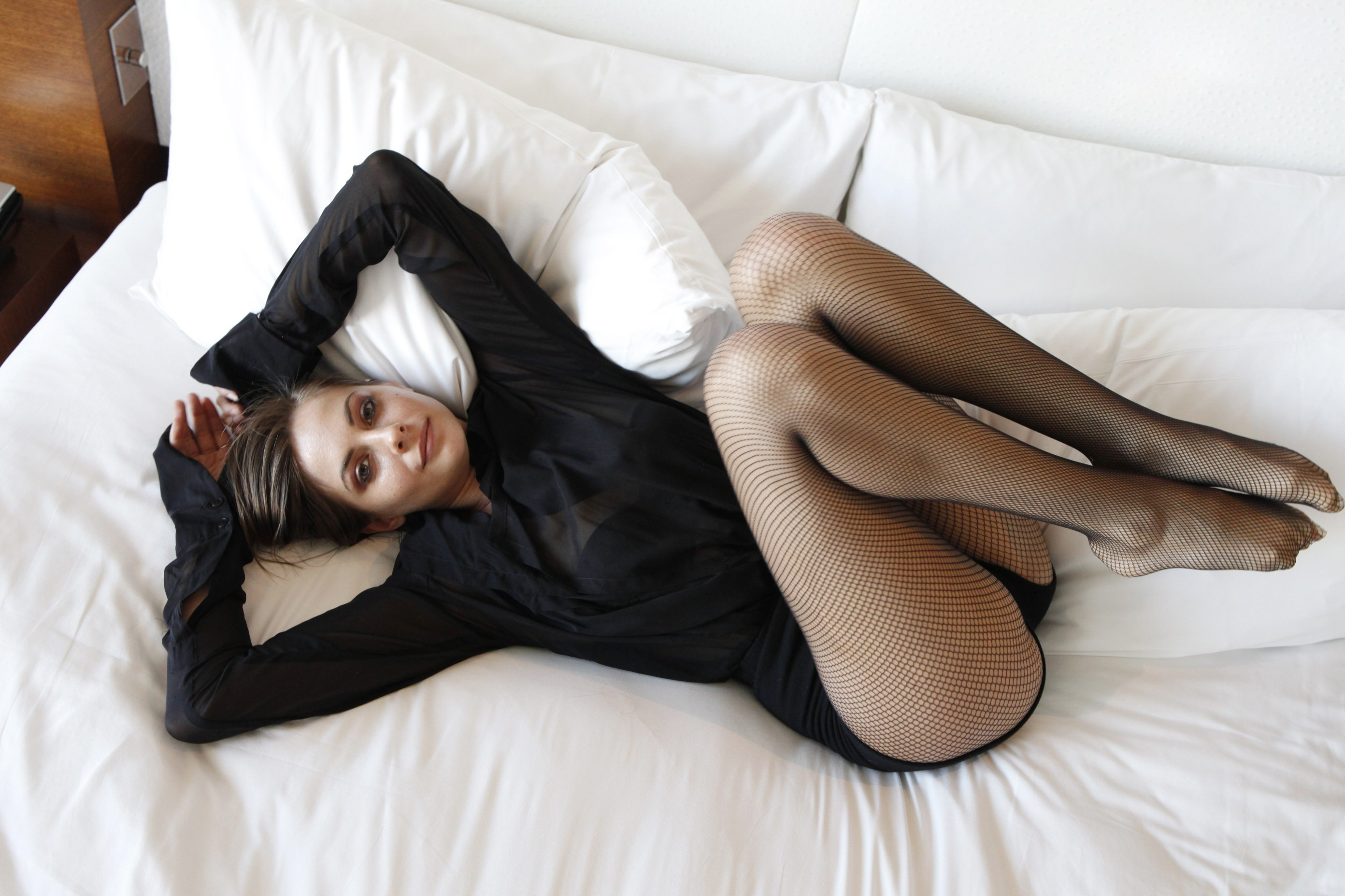 Willa Holland on bed